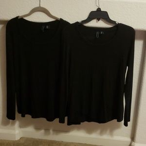 Two black long sleeve pullovers.